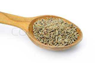 An image of cumin seeds in a spoon
