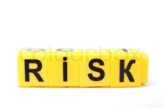 An image of yellow blocks with word ''risk'' on them