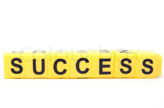 An image of yellow blocks with word ''success'' on them