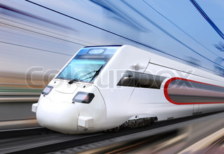 white super streamlined train with motion blur moves on railroad