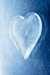 A Heart-shaped piece of ice on ice background