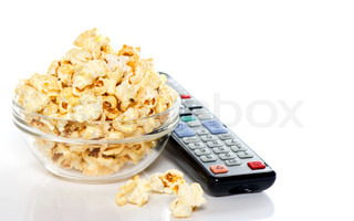 tv remote control and bowl with popcorn on white background tv watching concept
