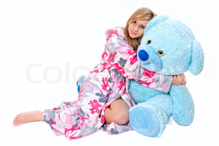 Beautiful young girl with her teddy