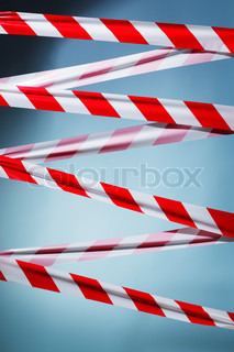 Red and white plastic barrier tape blocking the way