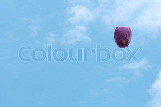 paper lantern with candle flying in the sky