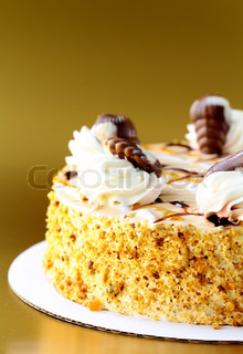 White Cream Icing Cake with Fruits and Chocolate