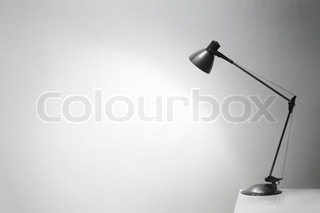 An office desk lamp illuminating the background