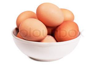 Brown eggs in a bowl over white background