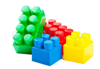 Colorful plastick building blocks isolated over white background