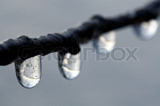 Closeup shot of icicles on grey background
