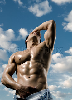 the very muscular handsome sexy guy on sky background, focus on face