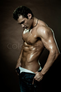 the very muscular handsome sexy guy on dark