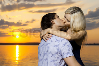 horizontal photo the very happysexy pretty couple, kiss, outdoor on sunset or sunrise