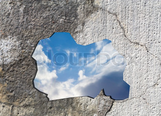 sky behind a concrete wall
