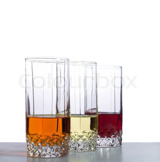 Three glasses with drinks on table