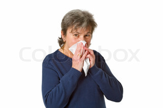 Senior woman blowing her nose with an handkerchief - isolated on white background