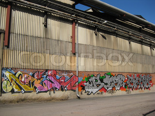 Illegal graffiti on the wall of abandoned factory building
