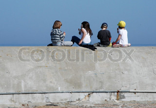 Kids on the Pier Wall Eating Ice Cream