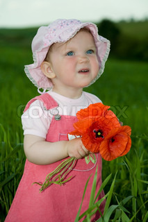 An image of baby-girl amongst field with poppies