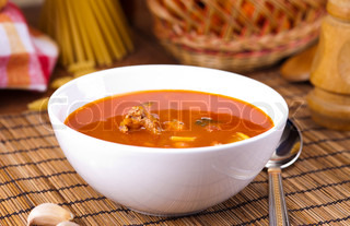 served tomato soup on table