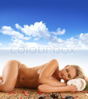 Young naked woman in spa isolated on white