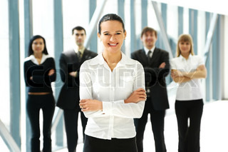 Business people in office WARNING! Focus only on the lady in front of image