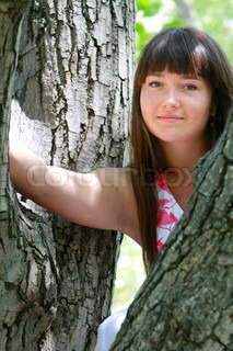 young smiling woman on natural background