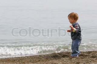 young boy on sea background