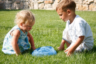 two children playing on natural background