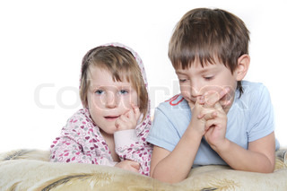 studio shot of two kids over white