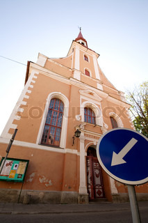 Traffic sign pointing out to Estonian church's door