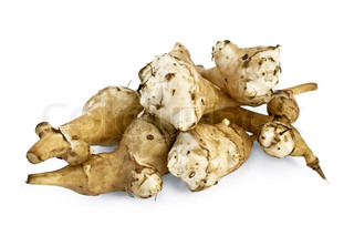 Several tubers of Jerusalem artichoke isolated on white background