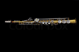 old clarinet isolated on the black background