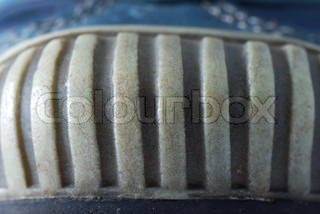 The structure of the soles on athletic shoes with grooves and rims