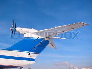 Aircraft tail with propellers on the background of blue sky