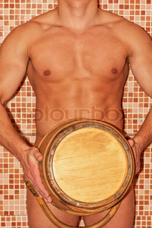 Closeup of beautiful muscular man at sauna