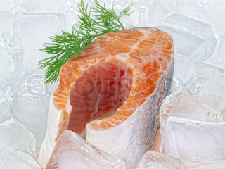 Fish steak . Fresh red fish steak with green leaf on the ice
