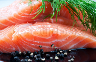 Salmon with black pepper and dill on plate close up