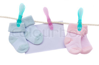 baby blue and pink socks with blank envelope hanging on rope on white