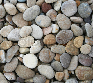 Grey pebbles on the beach can use as background