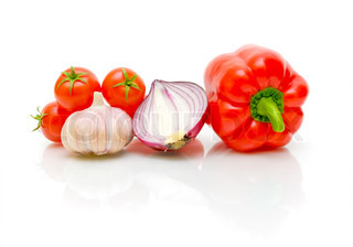 ripe cherry tomatoes, garlic, onions and peppers on a white background close-up
