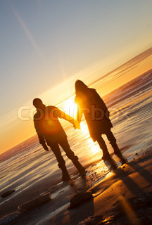 married couples in the sunset at the beach