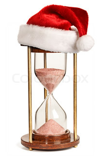 Christmas is coming concept - hourglasswith Santa Claus hat isolated on white background