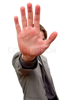 Young man showing stop sign with hand over white background