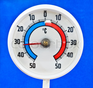 Outdoor thermometer Photos on a blue background
