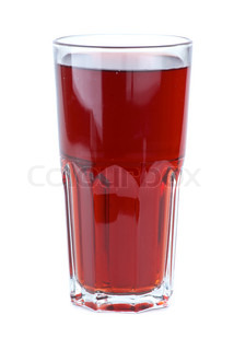 Glass filled with red pomegranate juice