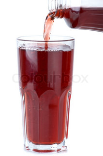 Glass poured with pomegranate juice