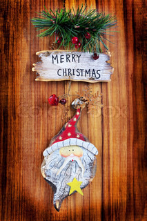 old Christmas ornaments on a wooden board