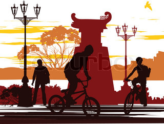two cyclists and one person on the street