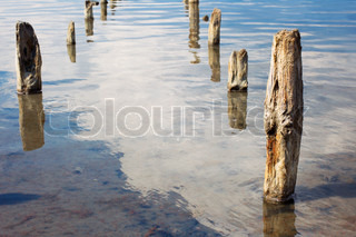 The old wooden pillars in the water salty Dead Sea